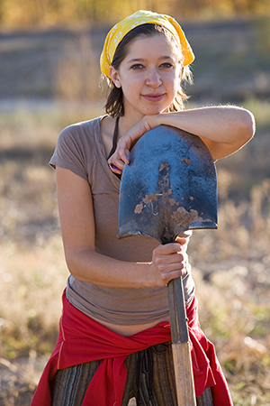 Make an Impact - girl holding a shovel